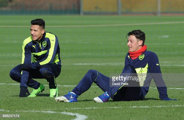 Mesut Ozil and Alexis Sanchez of Arsenal during the Arsenal Training Session at London Colney on February 14 2017 in St Albans England