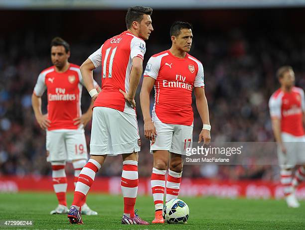 Mesut Ozil and Alexis Sanchez of Arsenal during the Barclays Premier League match between Arsenal and Swansea City at Emirates Stadium on May 11 2015...