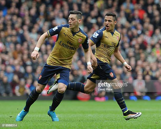 Mesut Ozil and Alexis Sanchez of Arsenal during the Barclays Premier League match between West Ham United and Arsenal at The Boleyn Ground on 9th...