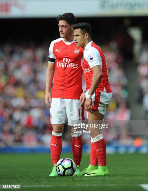 Mesut Ozil and Alexis Sanchez of Arsenal during the Premier League match between Arsenal and Manchester City at Emirates Stadium on April 2 2017 in...