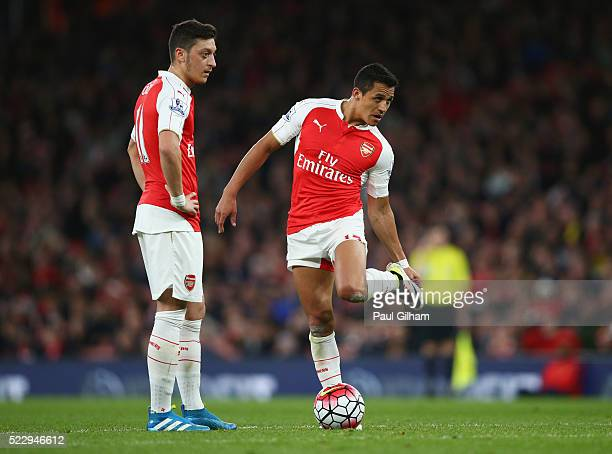 Mesut Ozil and Alexis Sanchez of Arsenal prepare to kick off during the Barclays Premier League match between Arsenal and West Bromwich Albion at the...