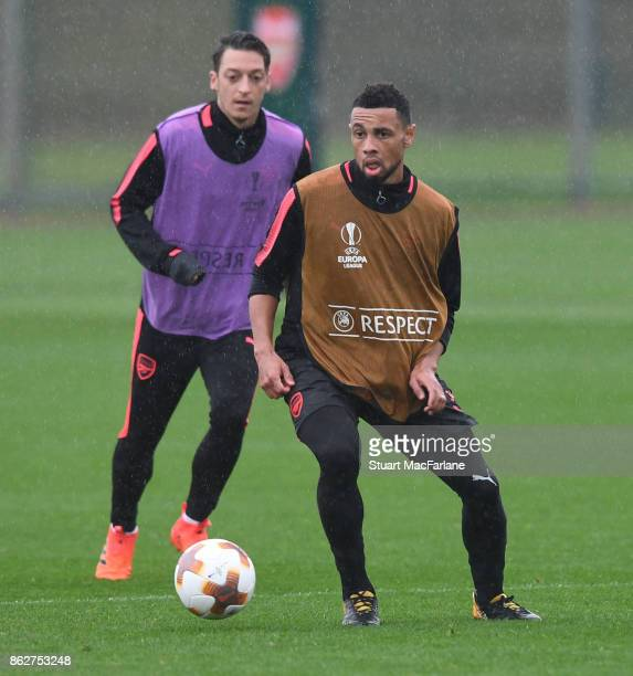 Mesut Ozil and Francis Coquelin of Arsenal during a training session at London Colney on October 18 2017 in St Albans England