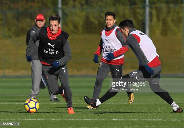 Mesut Ozil and Granit Xhaka of Arsenal during a training session at London Colney on November 17 2017 in St Albans England