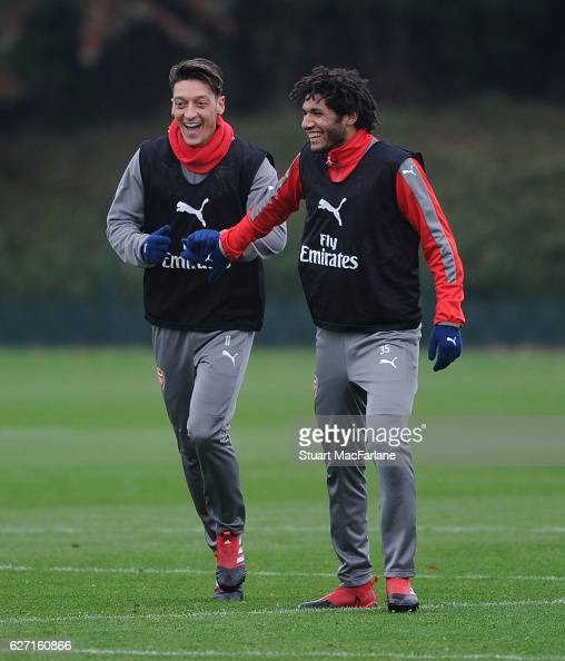 Mesut Ozil and Mohamed ELneny of Arsenal during a training session at London Colney on December 2 2016 in St Albans England