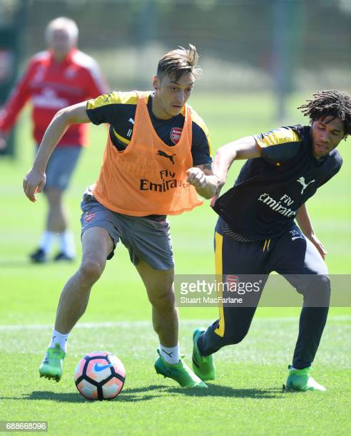 Mesut Ozil and Mohamed Elneny of Arsenal during a training session at London Colney on May 26 2017 in St Albans England