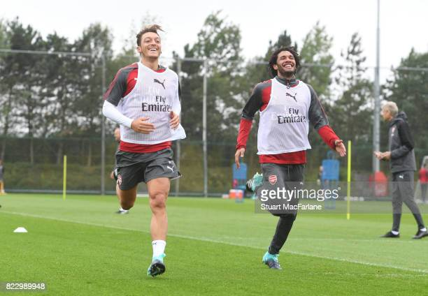 Mesut Ozil and Mohamed Elneny of Arsenal during a training session at London Colney on July 26 2017 in St Albans England