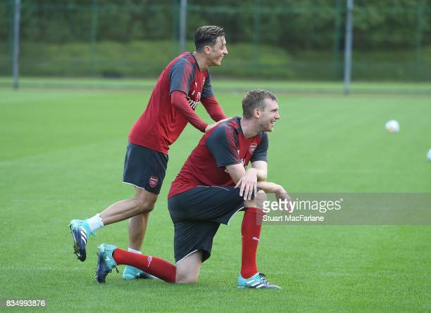 Mesut Ozil and Per Mertesacker of Arsenal during a training session at London Colney on August 18 2017 in St Albans England