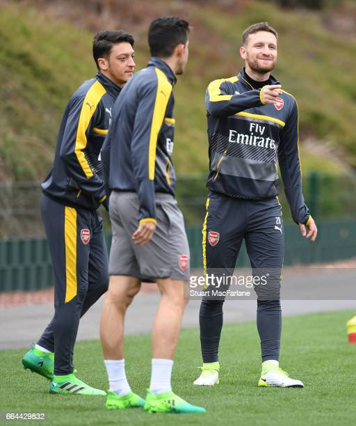Mesut Ozil and Shkodran Mustafi of Arsenal during a training session at London Colney on April 4 2017 in St Albans England