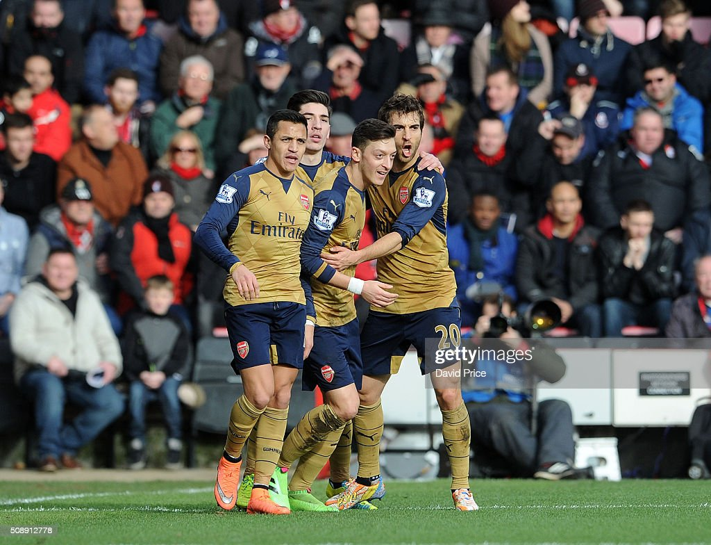 Mesut Ozil celebrates scoring Arsenal's 1st goal with <a gi-track='captionPersonalityLinkClicked' href=/galleries/search?phrase=Mathieu+Flamini&family=editorial&specificpeople=242961 ng-click='$event.stopPropagation()'>Mathieu Flamini</a> during the Barclays Premier League match between AFC Bournemouth and Arsenal at The Vitality Stadium, Bournemouth 7th February 2016.