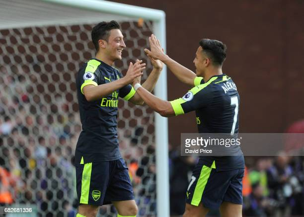 Mesut Ozil celebrates scoring Arsenal's 2nd goal with Alexis Sanchez during the Premier League match between Stoke City and Arsenal at Bet365 Stadium...