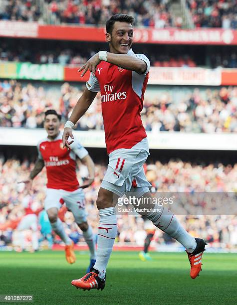 Mesut Ozil celebrates scoring the 2nd Arsenal goal during the Barclays Premier League match between Arsenal and Manchester United at Emirates Stadium...