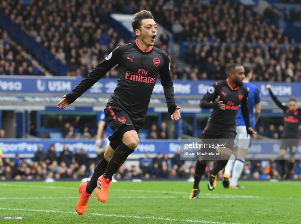 Mesut Ozil celebrates scoring the 2nd Arsenal goal during the Premier League match between Everton and Arsenal at Goodison Park on October 22, 2017 in Liverpool, England.