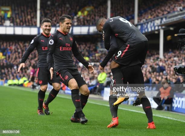 Mesut Ozil celebrates scoring the 2nd Arsenal goal with Alex Lacazette Sead Kolasinac and Granit Xhaka during the Premier League match between...