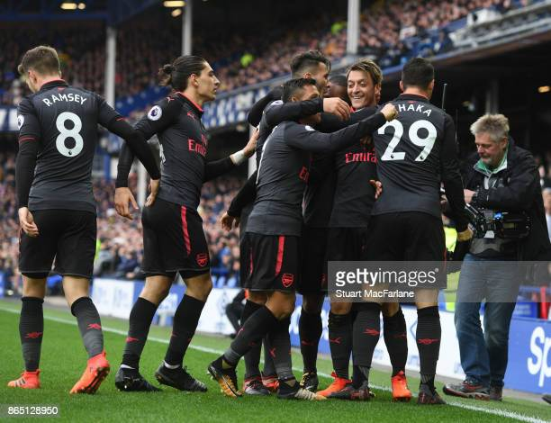 Mesut Ozil celebrates scoring the 2nd Arsenal goal with Granit Xhaka Alexis Sanchez and Hector Bellerin during the Premier League match between...
