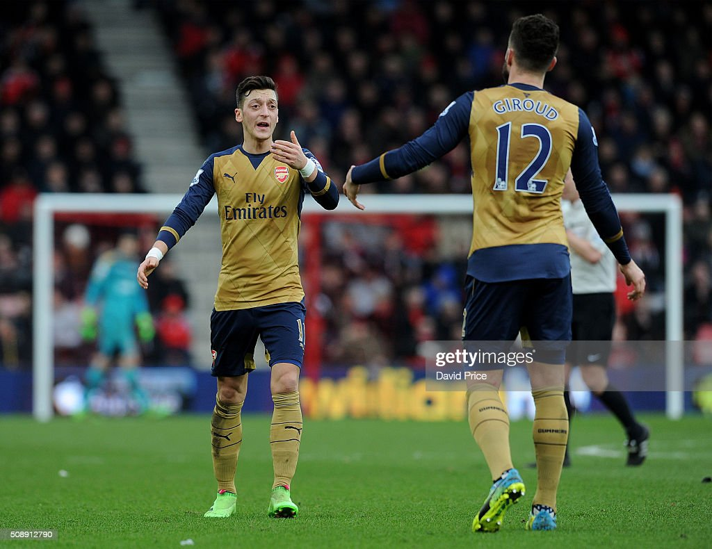 Mesut Ozil chats to <a gi-track='captionPersonalityLinkClicked' href=/galleries/search?phrase=Olivier+Giroud&family=editorial&specificpeople=5678034 ng-click='$event.stopPropagation()'>Olivier Giroud</a> of Arsenal during the Barclays Premier League match between AFC Bournemouth and Arsenal at The Vitality Stadium, Bournemouth 7th February 2016.