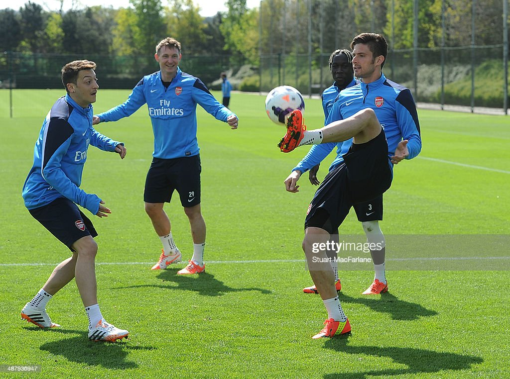ST ALBANS - ENGLAND, MAY 3. (L-R) Mesut Ozil, <a gi-track='captionPersonalityLinkClicked' href=/galleries/search?phrase=Kim+Kallstrom&family=editorial&specificpeople=539780 ng-click='$event.stopPropagation()'>Kim Kallstrom</a> and <a gi-track='captionPersonalityLinkClicked' href=/galleries/search?phrase=Olivier+Giroud&family=editorial&specificpeople=5678034 ng-click='$event.stopPropagation()'>Olivier Giroud</a> of Arsenal during a training session at London Colney on May 3, 2014 in St Albans, England.