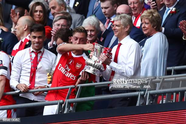 Mesut Ozil of Arsenal and Arsene Wenger head coach / manager of Arsenal lift The Emirates FA Cup during the Emirates FA Cup Final match between...
