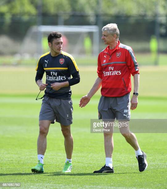 Mesut Ozil of Arsenal and Arsene Wenger the Arsenal Manager during the Arsenal Training Session at London Colney on May 24 2017 in St Albans England