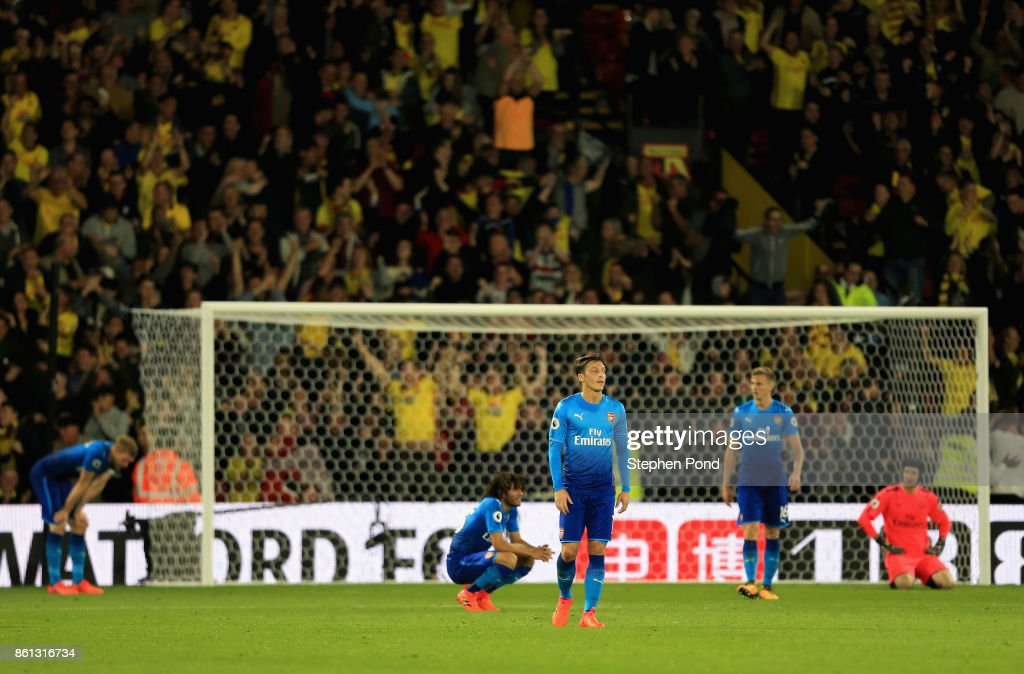 Mesut Ozil of Arsenal and team mates look dejected as Tom Cleverley of Watford scores their second goal during the Premier League match between Watford and Arsenal at Vicarage Road on October 14, 2017 in Watford, England.
