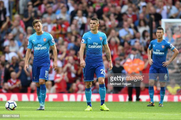 Mesut Ozil of Arsenal are Granit Xhaka of Arsenal are dejected after Liverpool's fourth goal during the Premier League match between Liverpool and...
