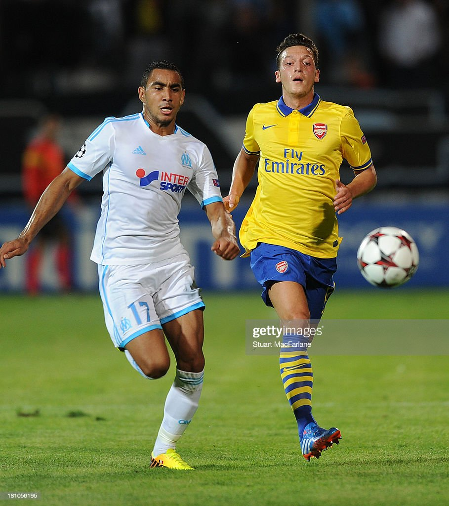 Mesut Ozil of Arsenal breaks past <a gi-track='captionPersonalityLinkClicked' href=/galleries/search?phrase=Dimitri+Payet&family=editorial&specificpeople=2137146 ng-click='$event.stopPropagation()'>Dimitri Payet</a> of Marseille during the match at Stade Velodrome on September 18, 2013 in Marseille, France.
