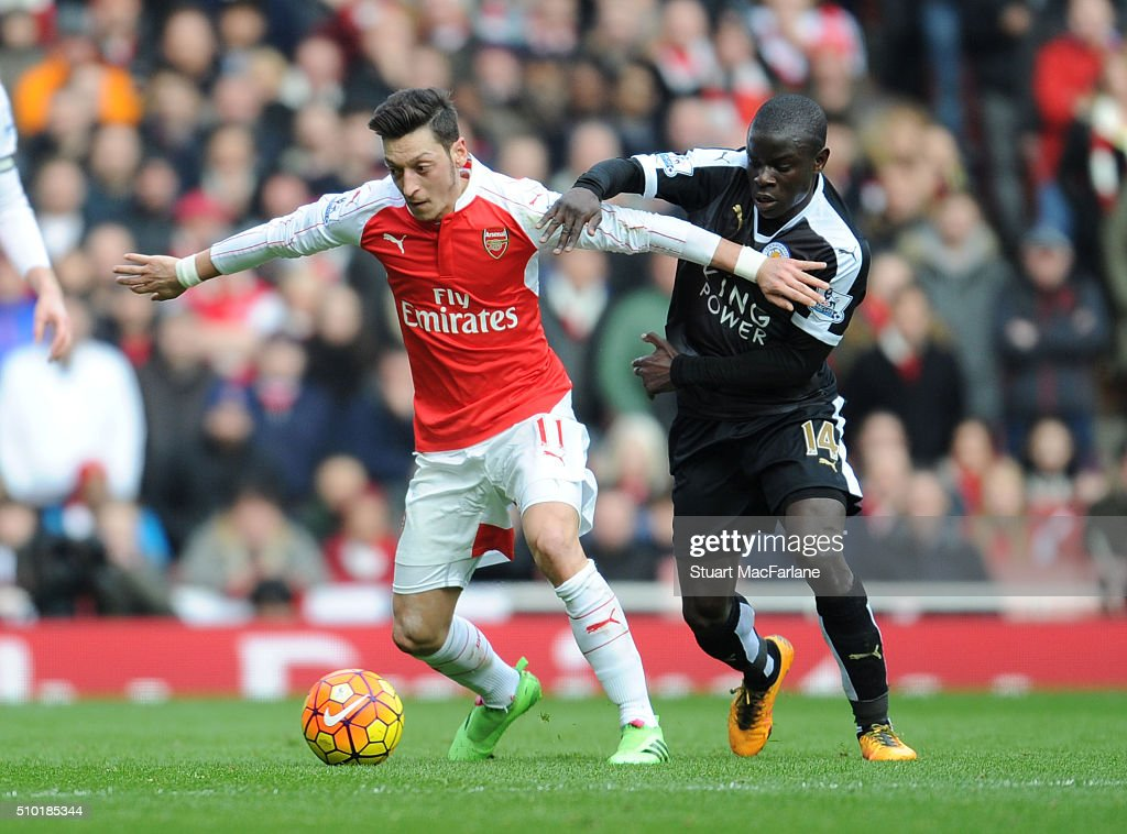 Mesut Ozil of Arsenal breaks past N'Golo Kante of Leicester during the Barclays Premier League match between Arsenal and Leicester City at Emirates Stadium on February 14, 2016 in London, England.