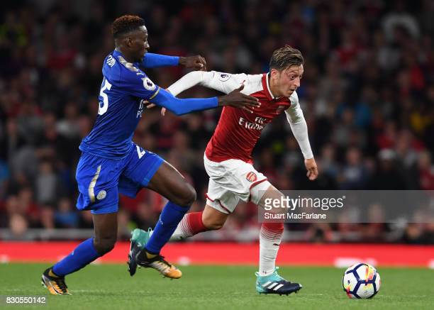 Mesut Ozil of Arsenal breaks past Wilfred Ndidi of Leicester during the Premier League match between Arsenal and Leicester City at Emirates Stadium...