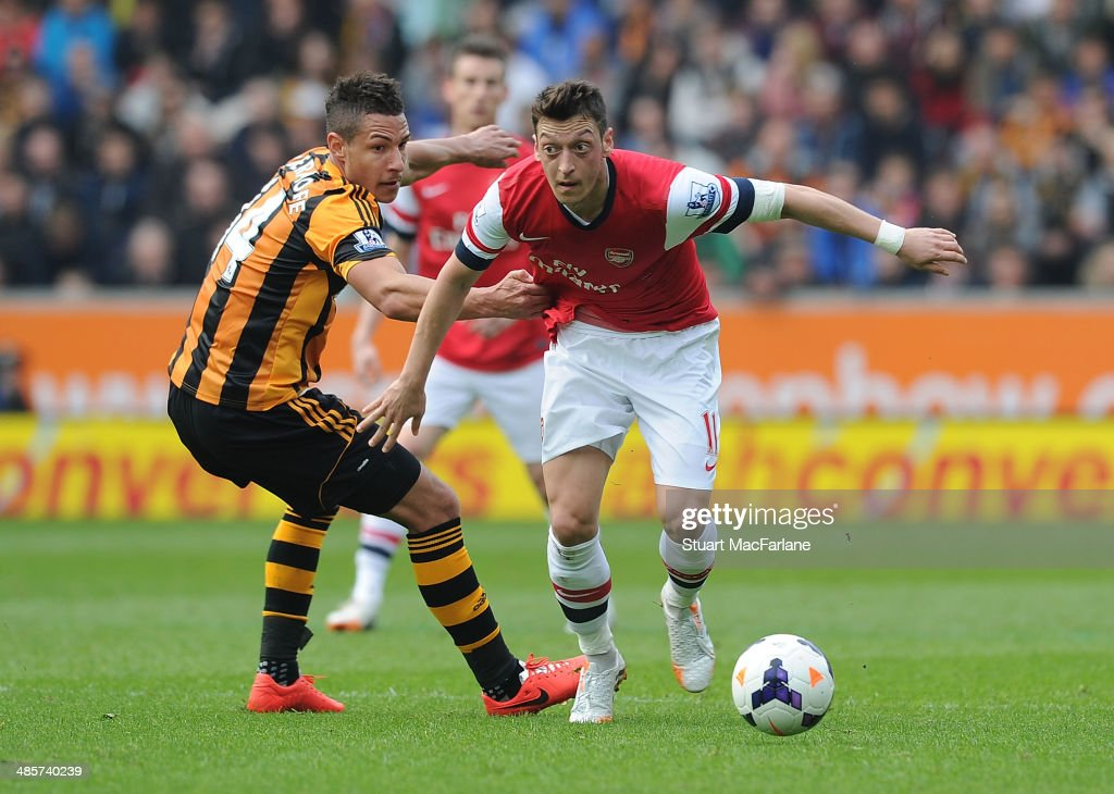 Mesut Ozil of Arsenal breraks past <a gi-track='captionPersonalityLinkClicked' href=/galleries/search?phrase=Jake+Livermore&family=editorial&specificpeople=5985311 ng-click='$event.stopPropagation()'>Jake Livermore</a> of Hull during the Barclays Premier League match between Hull City and Arsenal at the KC Stadium on April 20, 2014 in Hull, England.
