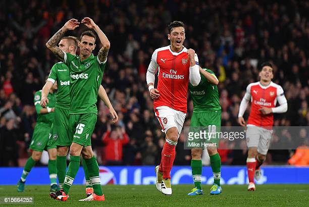 Mesut Ozil of Arsenal celebrates after scoring his thirs and his team's sixth goal of the game during the UEFA Champions League group A match between...