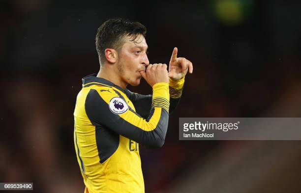 Mesut Ozil of Arsenal celebrates as he scores their second goal during the Premier League match between Middlesbrough and Arsenal at Riverside...