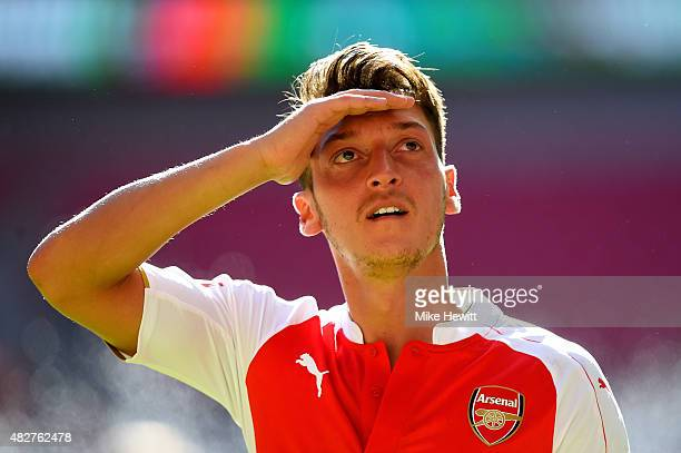 Mesut Ozil of Arsenal celebrates his team's 10 win after the FA Community Shield match between Chelsea and Arsenal at Wembley Stadium on August 2...