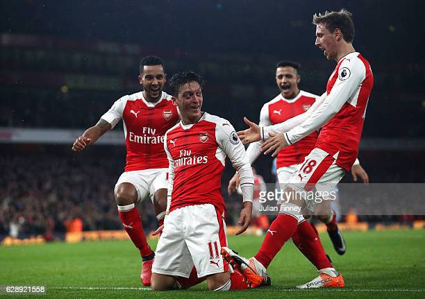 Mesut Ozil of Arsenal celebrates scoring his sides second goal with his Arsenal team mates during the Premier League match between Arsenal and Stoke...