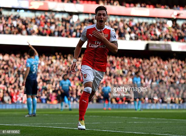 Mesut Ozil of Arsenal celebrates scoring his sides third goal during the Premier League match between Arsenal and Swansea City at Emirates Stadium on...