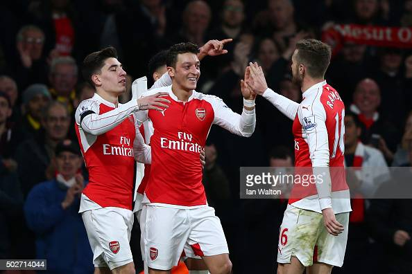 Mesut Ozil of Arsenal celebrates scoring his team's second goal with his team mates Hector Bellerin and Aaron Ramsey during the Barclays Premier...
