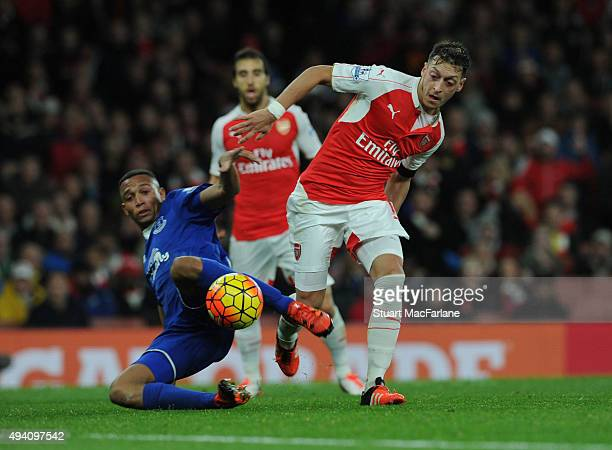 Mesut Ozil of Arsenal challenged by Brendan Galloway of Everton during the Barclays Premier League match between Arsenal and Everton at Emirates...