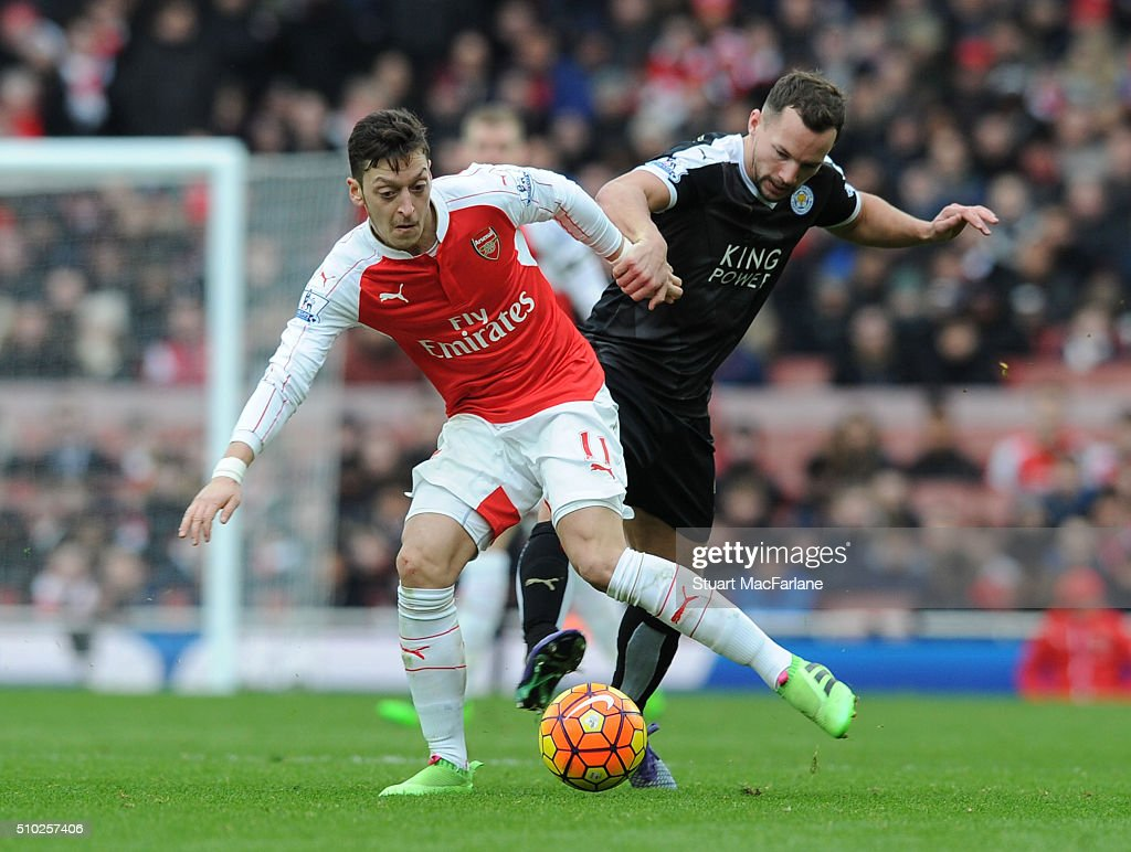 Mesut Ozil of Arsenal challenged by Christian Fuches of Leicester during the Barclays Premier League match between Arsenal and Leicester City at Emirates Stadium on February 14, 2016 in London, England.