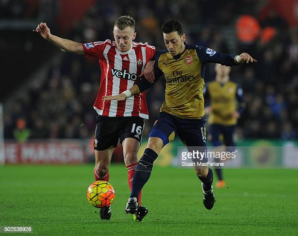 Mesut Ozil of Arsenal challenged by Cuco Martina of Southampton during the Barclays Premier League match between Southampton and Arsenal at St Mary's...