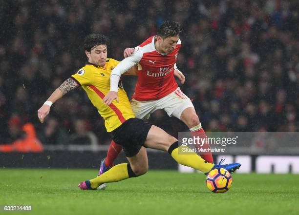 Mesut Ozil of Arsenal challenged by Daryl Janmaat of Watford during the Premier League match between Arsenal and Watford at Emirates Stadium on...