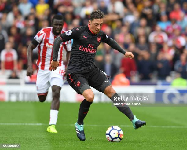 Mesut Ozil of Arsenal during the Premier League match between Stoke City and Arsenal at Bet365 Stadium on August 19 2017 in Stoke on Trent England