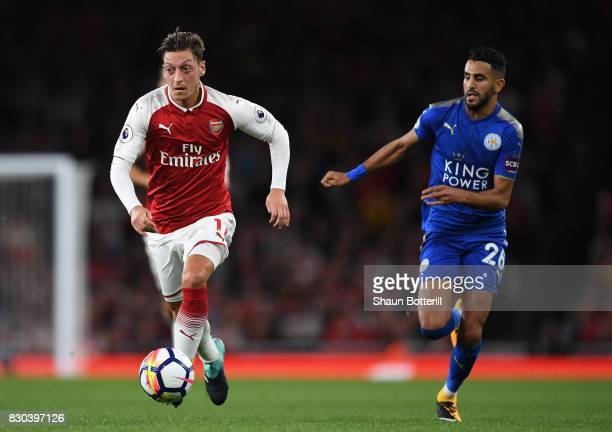 Mesut Ozil of Arsenal goes past Riyad Mahrez of Leicester City during the Premier League match between Arsenal and Leicester City at the Emirates...