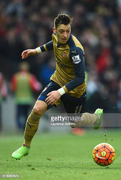 Mesut Ozil of Arsenal in action during the Barclays Premier League match between Manchester United and Arsenal at Old Trafford Stadium on February 28...