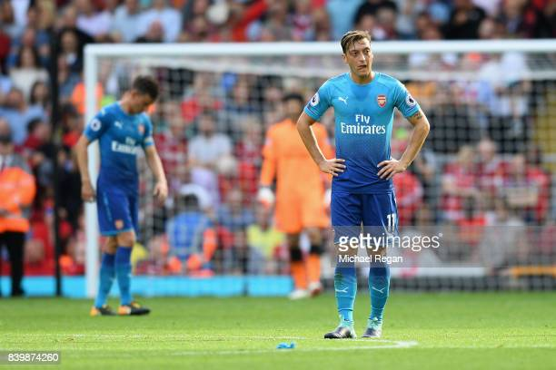Mesut Ozil of Arsenal is dejected after Liverpool's fourth goal during the Premier League match between Liverpool and Arsenal at Anfield on August 27...