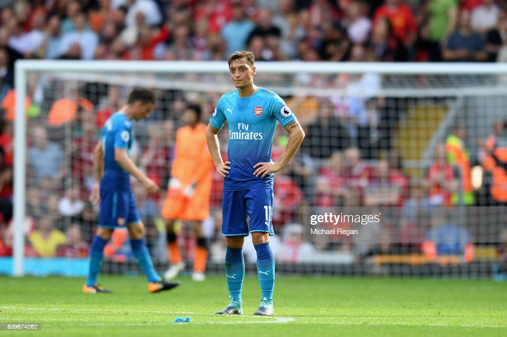Mesut Ozil of Arsenal is dejected after Liverpool's fourth goal during the Premier League match between Liverpool and Arsenal at Anfield on August 27, 2017 in Liverpool, England.