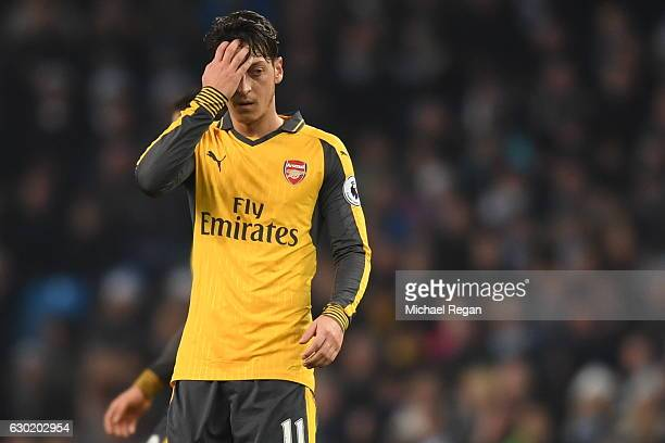 Mesut Ozil of Arsenal is dejected after the final whistle during the Premier League match between Manchester City and Arsenal at the Etihad Stadium...