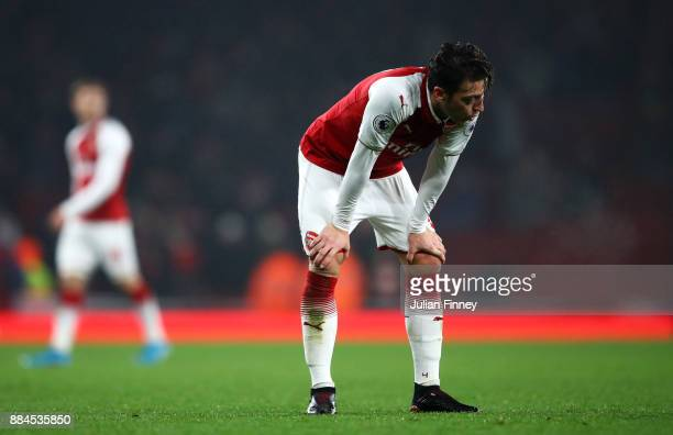 Mesut Ozil of Arsenal look dejected during the Premier League match between Arsenal and Manchester United at Emirates Stadium on December 2 2017 in...