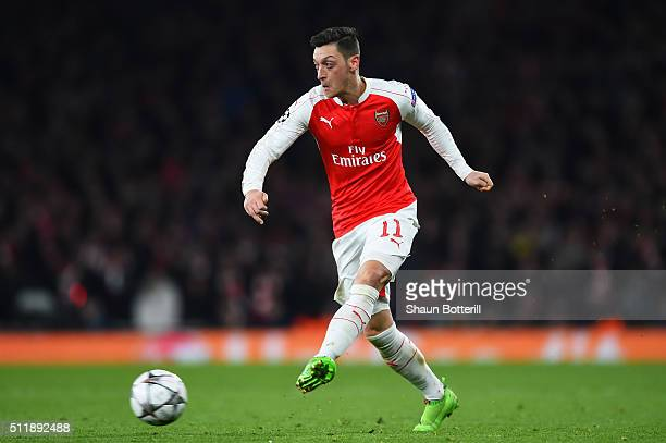 Mesut Ozil of Arsenal passes the ball during the UEFA Champions League round of 16 first leg match between Arsenal FC and FC Barcelona at the...