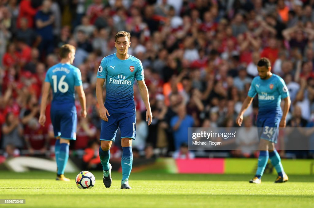 Mesut Ozil of Arsenal reacts during the Premier League match between Liverpool and Arsenal at Anfield on August 27, 2017 in Liverpool, England.