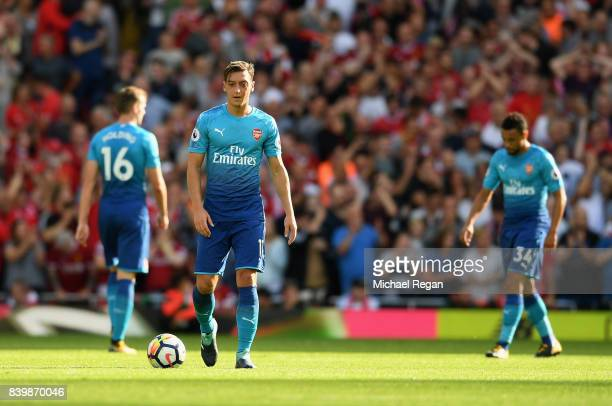 Mesut Ozil of Arsenal reacts during the Premier League match between Liverpool and Arsenal at Anfield on August 27 2017 in Liverpool England