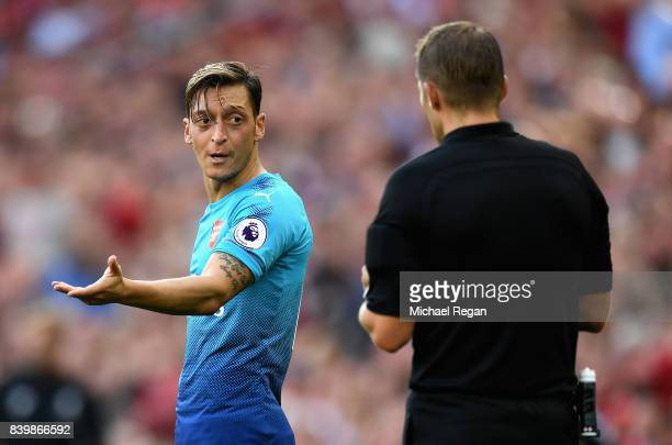 Mesut Ozil of Arsenal reacts to the referee during the Premier League match between Liverpool and Arsenal at Anfield on August 27 2017 in Liverpool...