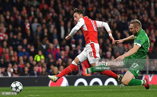 Mesut Ozil of Arsenal scores his team's fourth goal of the game during the UEFA Champions League group A match between Arsenal FC and PFC Ludogorets...